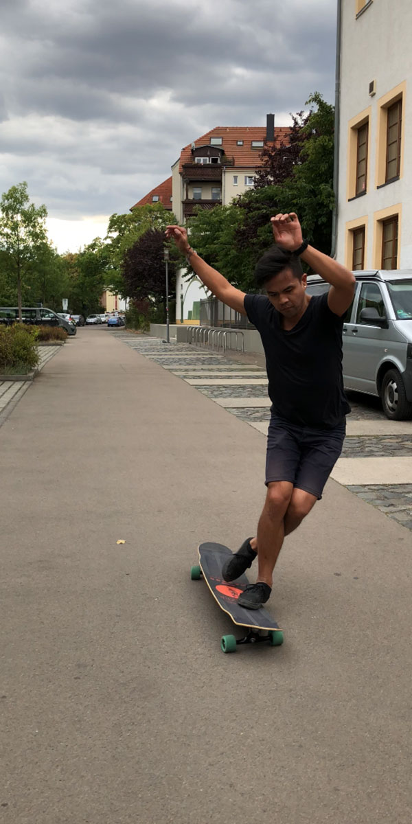 How to do a cross step on a longboard